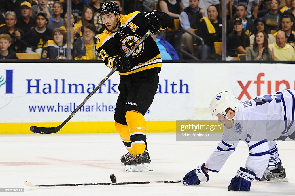 <a gi-track='captionPersonalityLinkClicked' href=/galleries/search?phrase=Patrice+Bergeron&family=editorial&specificpeople=204162 ng-click='$event.stopPropagation()'>Patrice Bergeron</a> #37 of the Boston Bruins shoots the puck against the Toronto Maple Leafs in Game Five of the Eastern Conference Quarterfinals during the 2013 NHL Stanley Cup Playoffs at TD Garden on May 10, 2013 in Boston, Massachusetts.