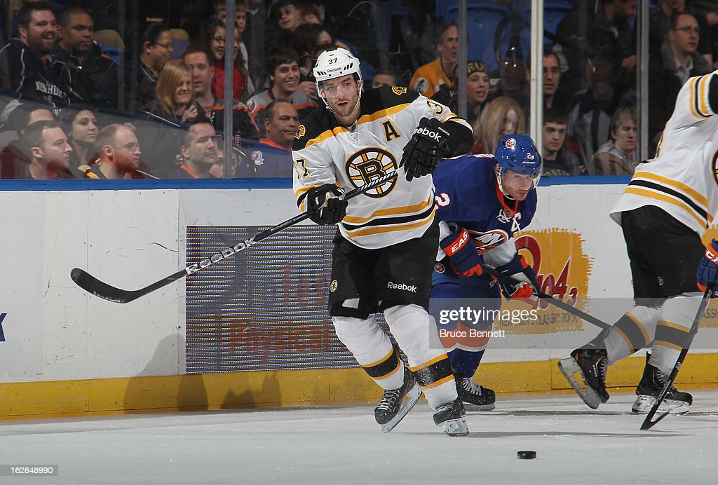 <a gi-track='captionPersonalityLinkClicked' href=/galleries/search?phrase=Patrice+Bergeron&family=editorial&specificpeople=204162 ng-click='$event.stopPropagation()'>Patrice Bergeron</a> #37 of the Boston Bruins skates against the New York Islanders at the Nassau Veterans Memorial Coliseum on February 28, 2013 in Uniondale, New York.