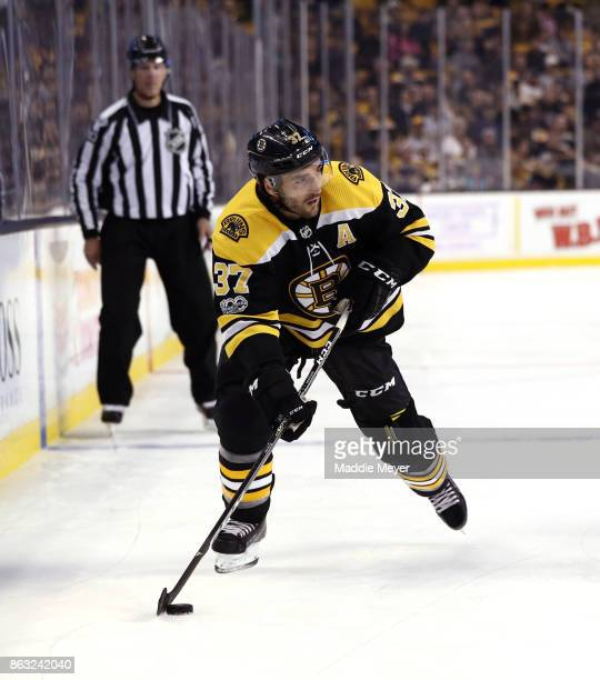 Patrice Bergeron of the Boston Bruins skates against the Vancouver Canucks during the first period at TD Garden on October 19 2017 in Boston...