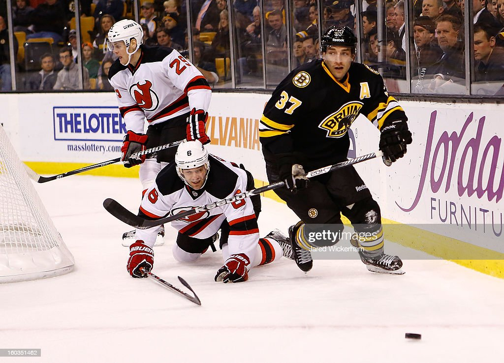 Patrice Bergeron #37 of the Boston Bruins skates to the puck ahead of Andy Greene #6 of the New Jersey Devils during the game on January 29, 2013 at TD Garden in Boston, Massachusetts.