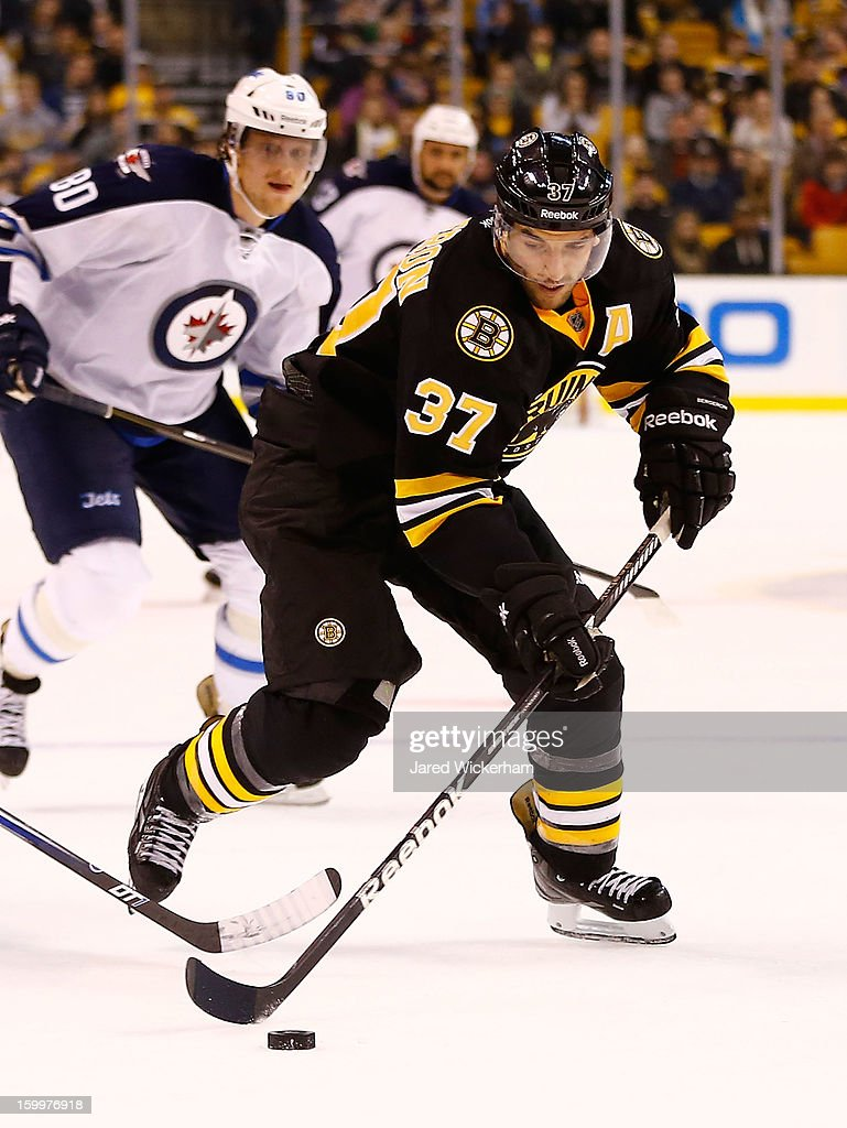 Patrice Bergeron #37 of the Boston Bruins skates with the puck against the Winnipeg Jets during the game on January 21, 2013 at TD Garden in Boston, Massachusetts.