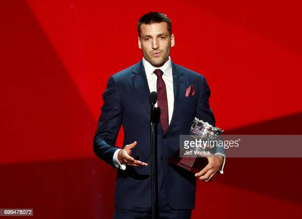 Patrice Bergeron of the Boston Bruins speaks onstage after receiving the Frank J Selke Trophy during the 2017 NHL Awards Expansion Draft at TMobile...