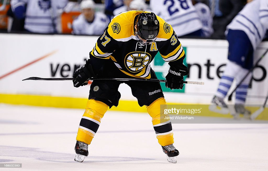 <a gi-track='captionPersonalityLinkClicked' href=/galleries/search?phrase=Patrice+Bergeron&family=editorial&specificpeople=204162 ng-click='$event.stopPropagation()'>Patrice Bergeron</a> #37 of the Boston Bruins takes a break following a timeout in the third period against the Toronto Maple Leafs in Game Five of the Eastern Conference Quarterfinals during the 2013 NHL Stanley Cup Playoffs on May 10, 2013 at TD Garden in Boston, Massachusetts.