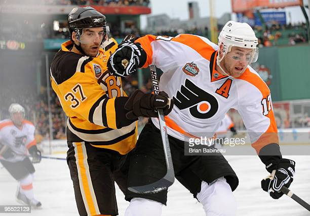 Patrice Bergeron of the Boston Bruins watches the play against Jeff Carter of the Philadelphia Flyers in the 2010 Bridgestone Winter Classic at...