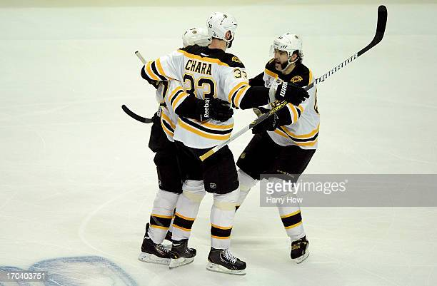 Patrice Bergeron Zdeno Chara and Jaromir Jagr of the Boston Bruins celebrate after Bergeron scored a goal in the third period against the Chicago...