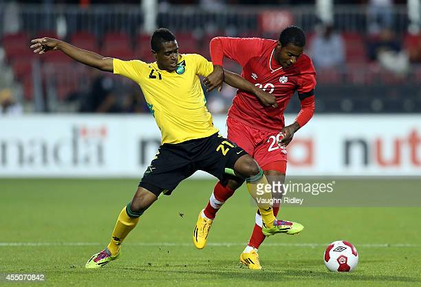 Patrice Bernier of Canada battles for the ball with Deshorn Brown of Jamaica during the International Friendly match between Canada and Jamaica at...