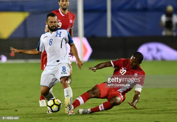 Patrice Bernier of Canada defends the ball against Alfredo Mejia of Honduras during their CONCACAF Gold Cup match on July 14 2017 in Frisco Texas /...