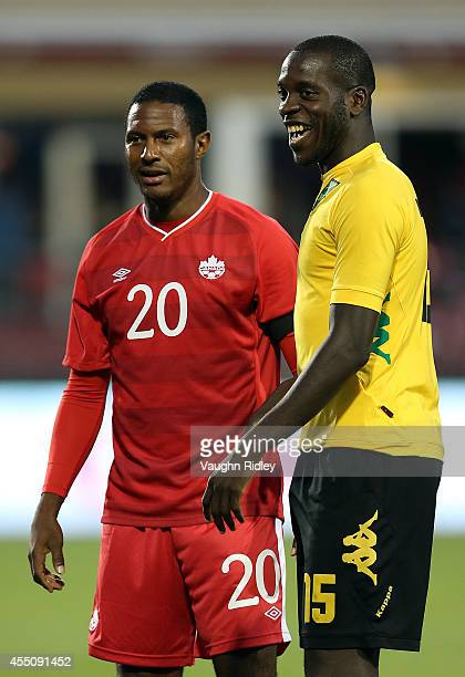 Patrice Bernier of Canada laughs with JeVaughn Watson of Jamaica during the International Friendly match between Canada and Jamaica at BMO Field on...