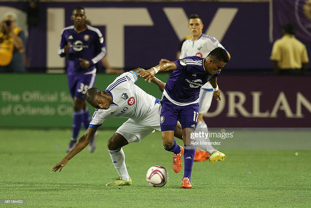 Patrice Bernier #8 of Montreal Impact and Darwin Ceren #17 of Orlando City SC fight for the ball during an MLS soccer match between the Montreal Impact and the Orlando City SC at the Orlando Citrus Bowl on October 3, 2015 in Orlando, Florida. Orlando won the match 2-1.
