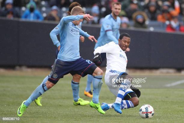 Patrice Bernier of Montreal Impact is challenged by Alexander Ring of New York City FC during the New York City FC Vs Montreal Impact regular season...