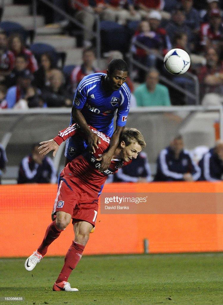 Patrice Bernier #8 of Montreal Impact jumps on the back of <a gi-track='captionPersonalityLinkClicked' href=/galleries/search?phrase=Chris+Rolfe&family=editorial&specificpeople=887999 ng-click='$event.stopPropagation()'>Chris Rolfe</a> #18 of Chicago Fire in an MLS match on September 15, 2012 at Toyota Park in Bridgeview, Illinois. The Chicago Fire defeated the Montreal Impact 3-1.