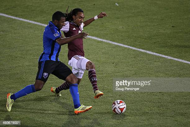 Patrice Bernier of the Montreal Impact and Marlon Hairston of the Colorado Rapids battle for control of the ball at Dick's Sporting Goods Park on May...