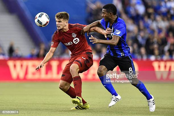 Patrice Bernier of the Montreal Impact challenges Nick Hagglund of the Toronto FC during leg one of the MLS Eastern Conference finals at Olympic...