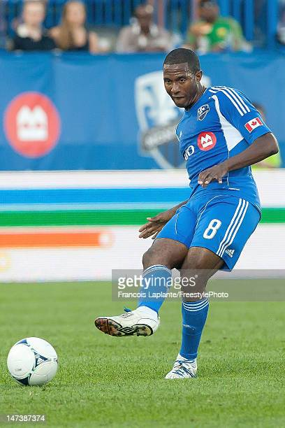 Patrice Bernier of the Montreal Impact passes the ball during the MLS match against the Houston Dynamo at Saputo Stadium on June 23 2012 in Montreal...