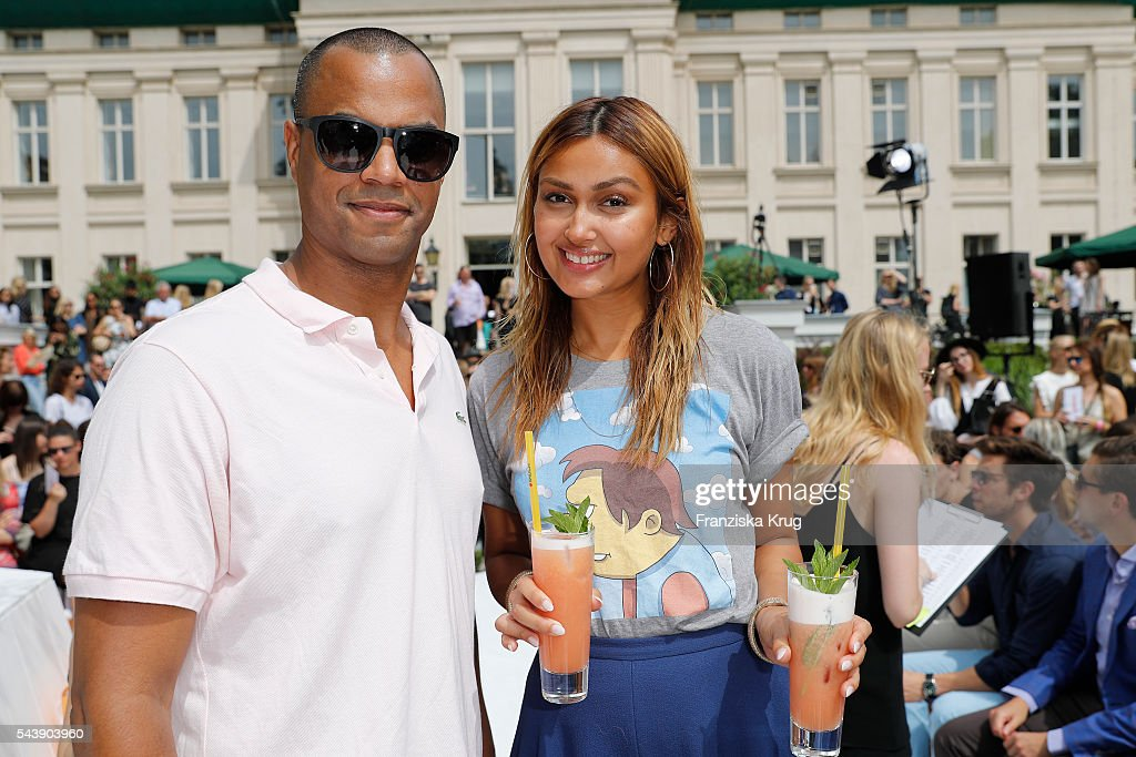 Patrice Bouedibela and Wanda Limar attend the presentation of the Rauch Happy Day Limited Edition designed by Marina Hoermanseder ahead of the Marina Hoermanseder defilee during the Der Berliner Mode Salon Spring/Summer 2017 at Kronprinzenpalais on June 30, 2016 in Berlin, Germany.
