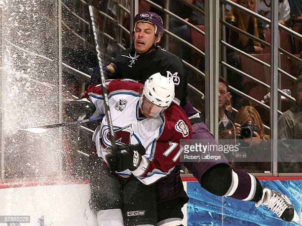 Patrice Brisebois of the Colorado Avalanche is checked into the glass by Ryan Getzlaf of the Mighty Ducks of Anaheim in game two of the Western...