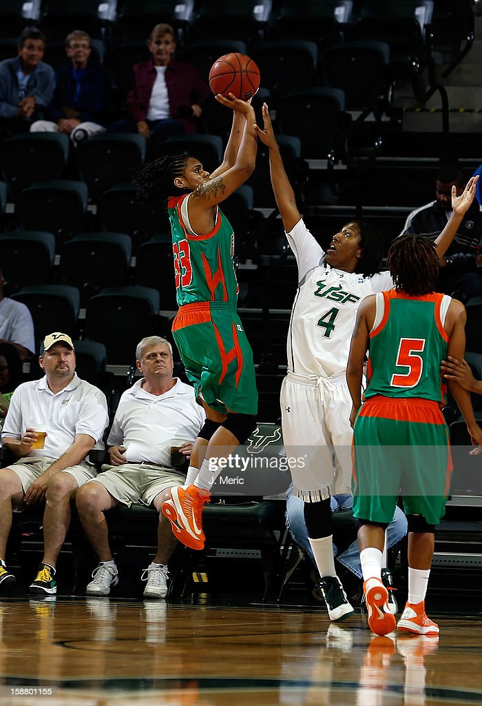 Patrice Collie #33 of the Florida A&M Rattlers shoots as Tiffany Conner #4 of the South Florida Bulls defends during the game at the Sun Dome on December 29, 2012 in Tampa, Florida.