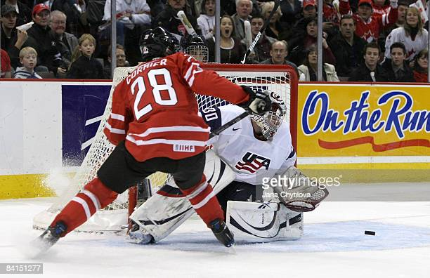 Patrice Cormier of Team Canada watches the rebound asThomas McCollum of Team USA during the IIHF World Junior Championships held at Scotiabank Place...