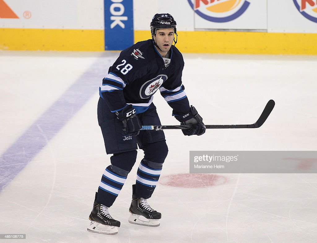 Patrice Cormier #28 of the Winnipeg Jets skates down the ice during the first period of the NHL game against the Boston Bruins at the MTS Centre on April 10, 2014 in Winnipeg, Manitoba, Canada.