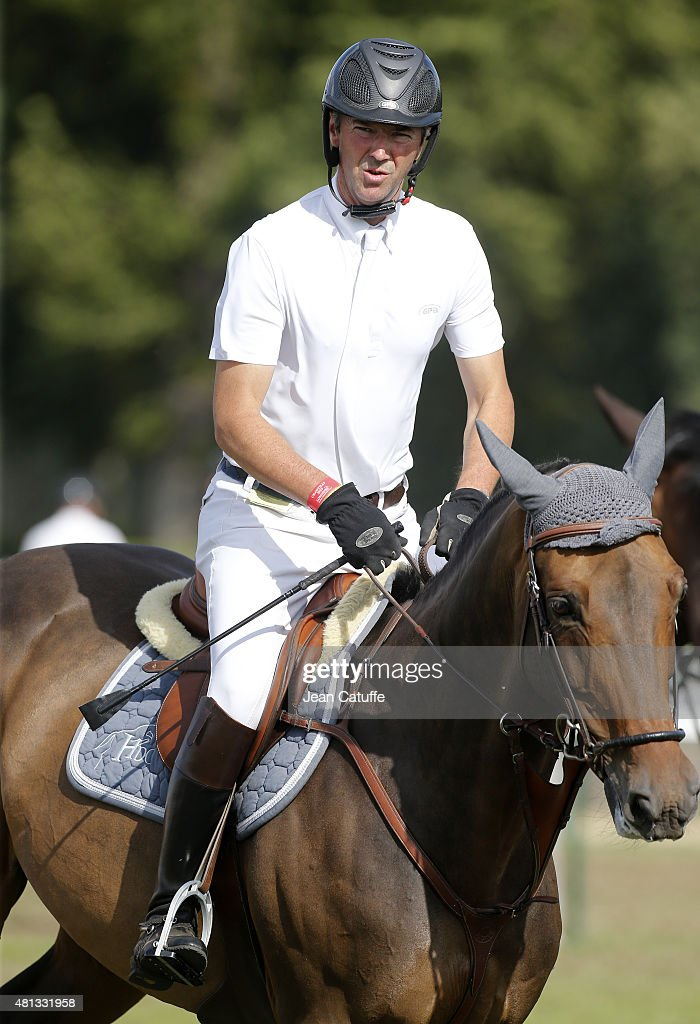 <a gi-track='captionPersonalityLinkClicked' href=/galleries/search?phrase=Patrice+Delaveau&family=editorial&specificpeople=2328789 ng-click='$event.stopPropagation()'>Patrice Delaveau</a> of France competes in the Longines Global Champions Tour on July 17, 2015 in Chantilly, France.