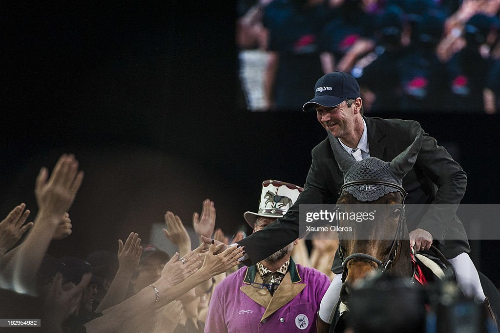 Patrice Delaveau of France greets the crowd after winning the Longines Hong Kong Masters International Show Jumping at Asia World Expo on March 2, 2013 in Hong Kong, Hong Kong.