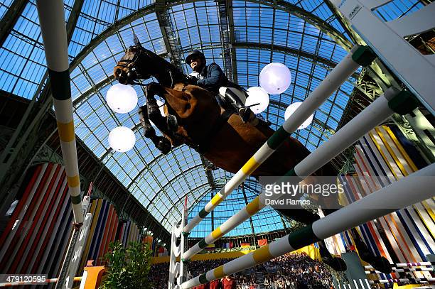 Patrice Delaveau of France on Lacrimoso HDC in action to finish second during the Grand Prix Hermes Final as part of the third day of the Grand Prix...