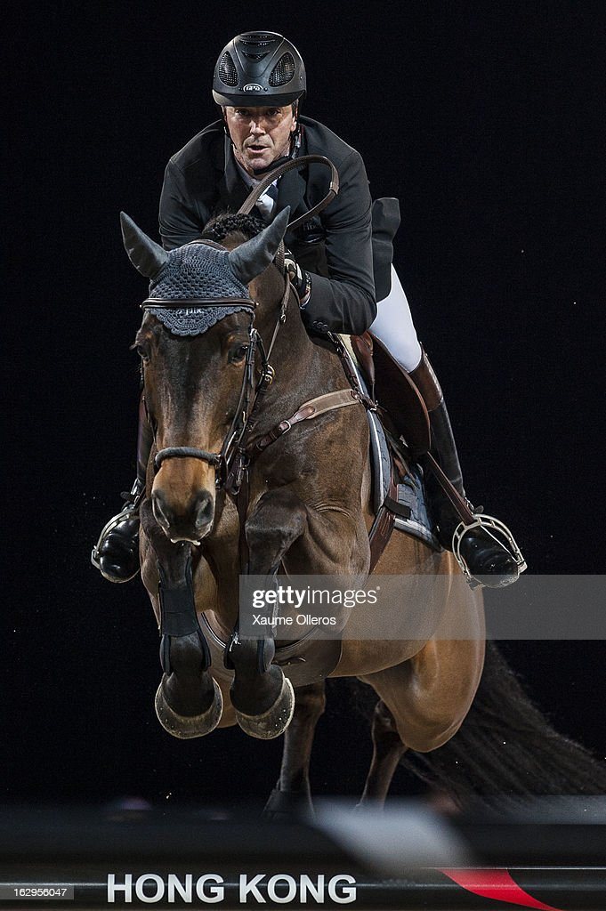 Patrice Delaveau of France rides Lacrimoso 3 HDC at the Longines Grand Prix during the Longines Hong Kong Masters International Show Jumping at Asia...