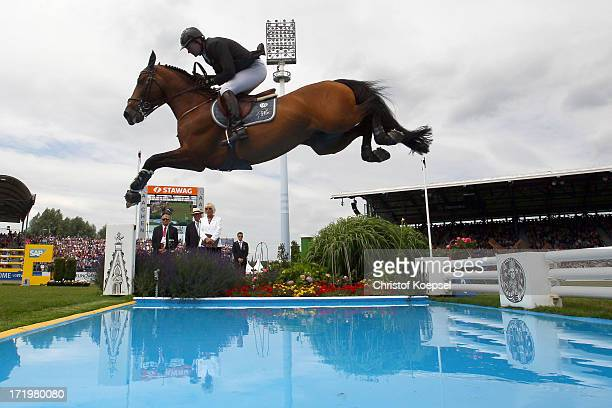 Patrice Delaveau of France rideson Orient Express and won the thrid place during the Rolex Grand Prix jumping competition during the 2013 CHIO Aachen...