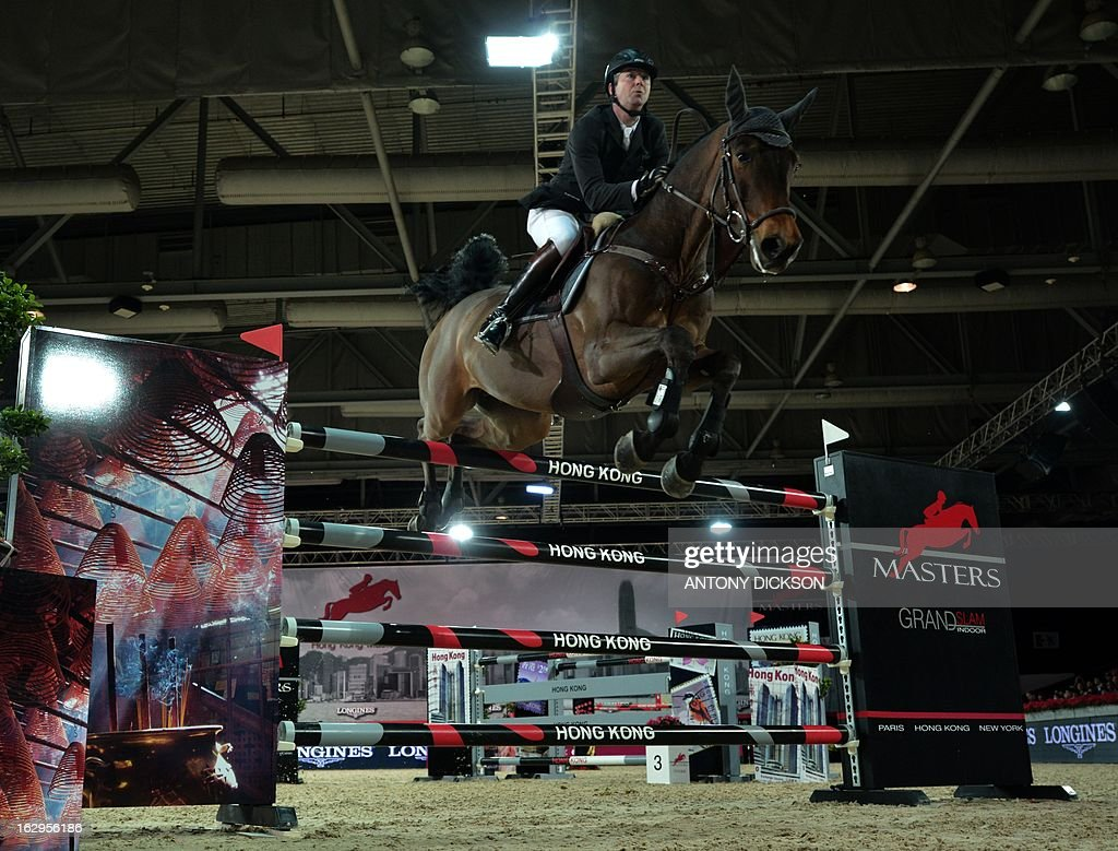 Patrice Delaveau of France riding Lacrimoso 3 competes in the international jumping competition Grand Prix equestrian event in Hong Kong on March 2, 2013. AFP PHOTO / Antony DICKSON