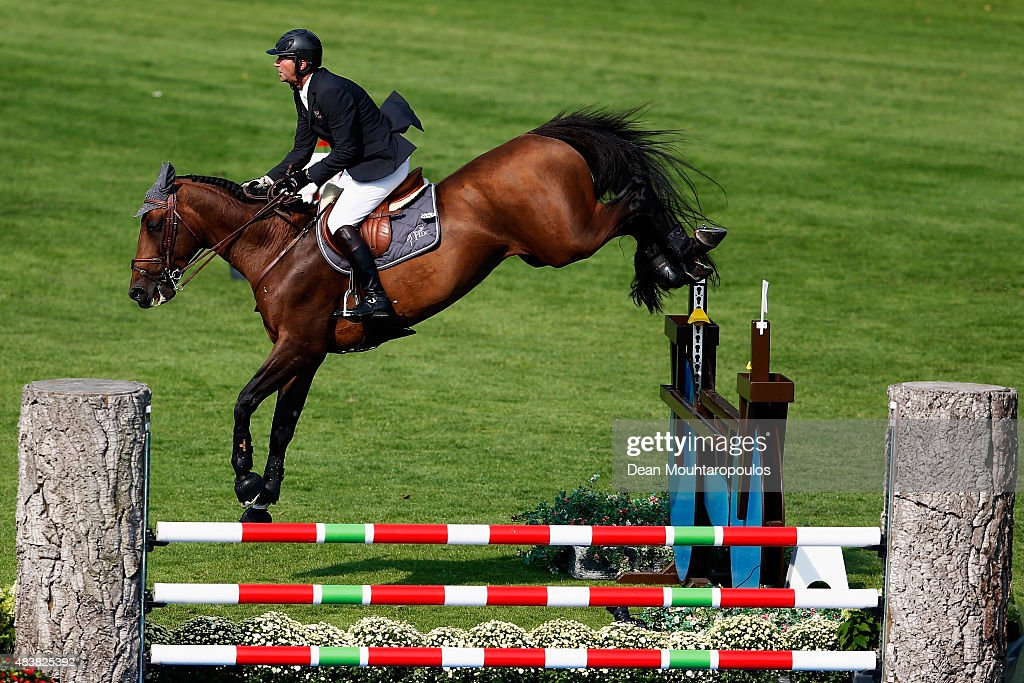 <a gi-track='captionPersonalityLinkClicked' href=/galleries/search?phrase=Patrice+Delaveau&family=editorial&specificpeople=2328789 ng-click='$event.stopPropagation()'>Patrice Delaveau</a> of France riding Orient Express HDC competes in the Class 01, CSI5* 1.45m Two Phases: A + A, against the clock during the Longines Global Champions Tour held at Stal Tops on August 13, 2015 in Valkenswaard, Netherlands.