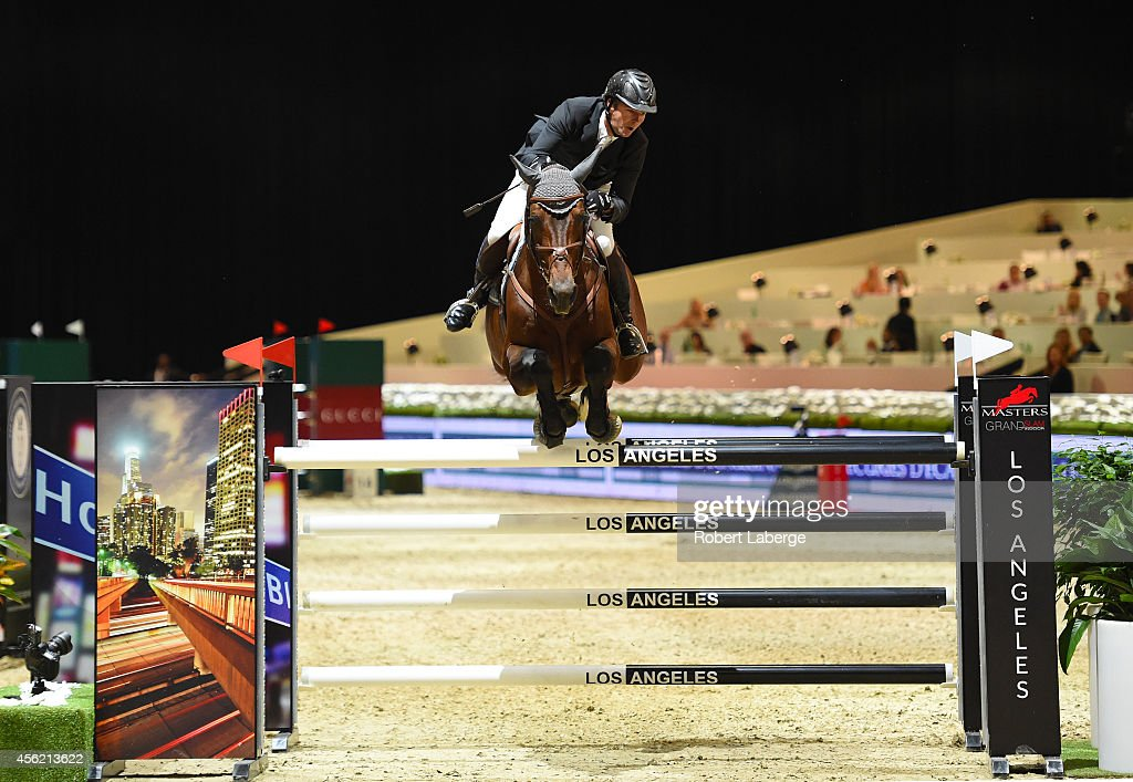 <a gi-track='captionPersonalityLinkClicked' href=/galleries/search?phrase=Patrice+Delaveau&family=editorial&specificpeople=2328789 ng-click='$event.stopPropagation()'>Patrice Delaveau</a> rides Carinjo in the FOX Sports Trophy class at Longines Los Angeles Masters at Los Angeles Convention Center on September 27, 2014 in Los Angeles, California.
