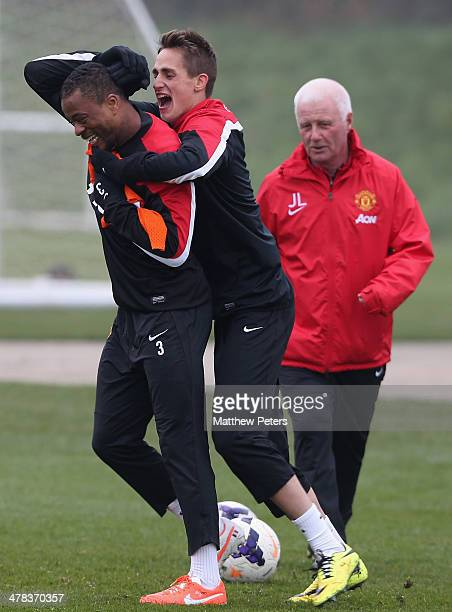 Patrice Evra and Adnan Januzaj of Manchester United in action during a first team training session at Aon Training Complex on March 13 2014 in...