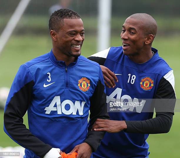 Patrice Evra and Ashley Young of Manchester United in action during a first team training session at Aon Training Complex on October 18 2013 in...