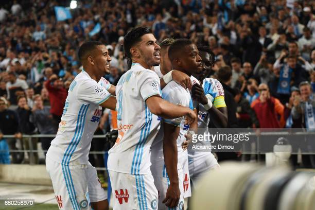 Patrice Evra and Morgan Sanson and Dimitri Payet and Bafetimbi Gomis and William Vainqueur of Marseille celebrates the goal of Patrice Evra during...
