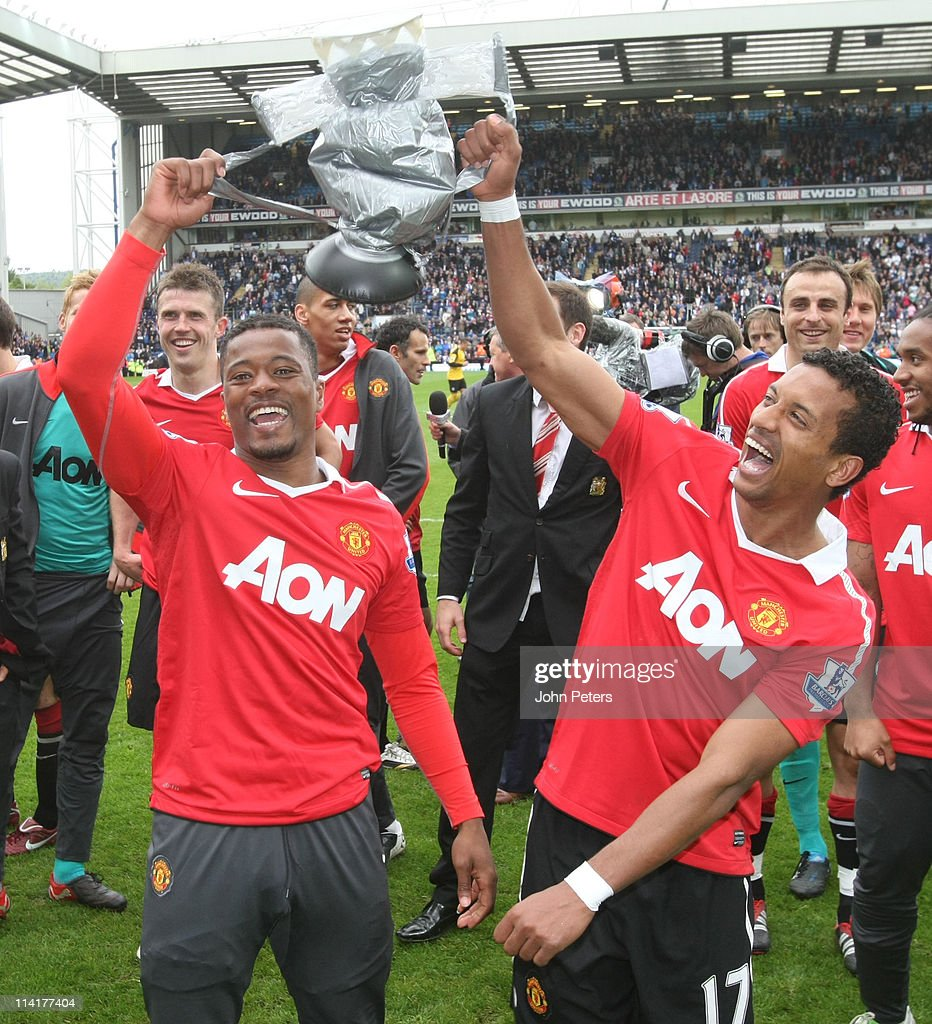 Patrice Evra and Nani of Manchester United celebrates winning the Premier League title after the Barclays Premier League match between Blackburn Rovers and Manchester United at Ewood Park on May 14, 2011 in Blackburn, England.