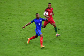 Patrice Evra of France and Nani of Portugal during the European Championship Final between Portugal and France at Stade de France on July 10 2016 in...