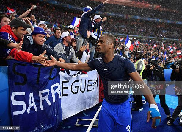 Patrice Evra of France celebrates with the supporters after his team's 52 win in the UEFA EURO 2016 quarter final match between France and Iceland at...