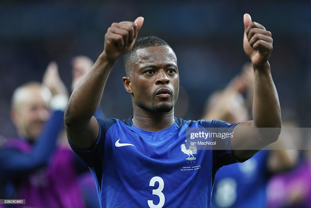 <a gi-track='captionPersonalityLinkClicked' href=/galleries/search?phrase=Patrice+Evra&family=editorial&specificpeople=714865 ng-click='$event.stopPropagation()'>Patrice Evra</a> of France gestures to the fans during the UEFA EURO 2016 Group A match between France and Romania at Stade de France on June 10, 2016 in Paris, France.