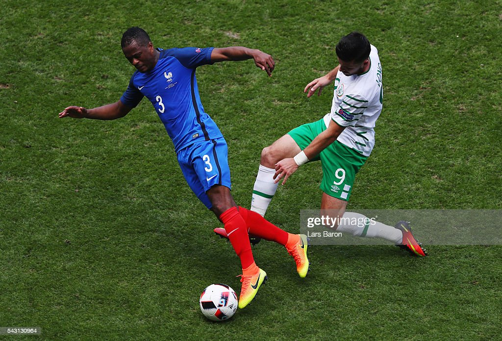 <a gi-track='captionPersonalityLinkClicked' href=/galleries/search?phrase=Patrice+Evra&family=editorial&specificpeople=714865 ng-click='$event.stopPropagation()'>Patrice Evra</a> of France is challenged by <a gi-track='captionPersonalityLinkClicked' href=/galleries/search?phrase=Shane+Long&family=editorial&specificpeople=661194 ng-click='$event.stopPropagation()'>Shane Long</a> of Republic of Ireland during the UEFA EURO 2016 round of 16 match between France and Republic of Ireland at Stade des Lumieres on June 26, 2016 in Lyon, France.