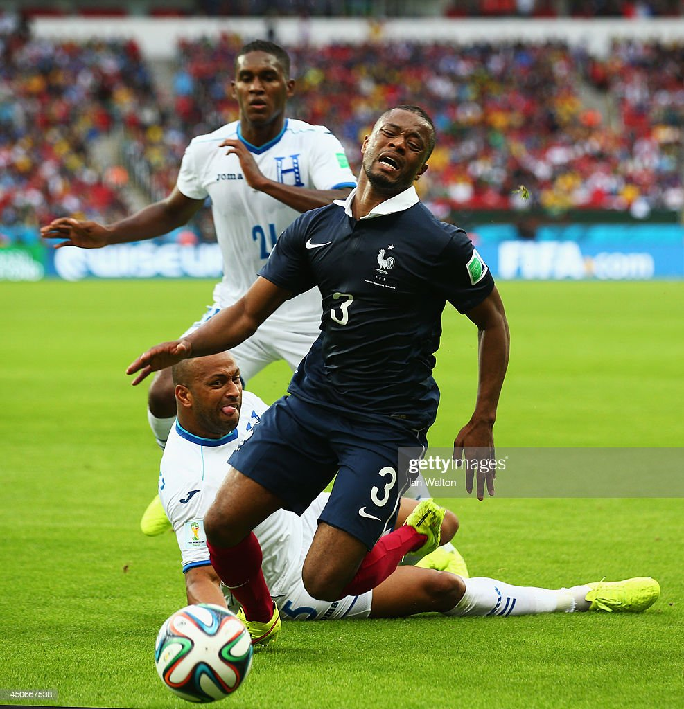 <a gi-track='captionPersonalityLinkClicked' href=/galleries/search?phrase=Patrice+Evra&family=editorial&specificpeople=714865 ng-click='$event.stopPropagation()'>Patrice Evra</a> of France reacts after a challenge by <a gi-track='captionPersonalityLinkClicked' href=/galleries/search?phrase=Victor+Bernardez&family=editorial&specificpeople=2952273 ng-click='$event.stopPropagation()'>Victor Bernardez</a> of Honduras during the 2014 FIFA World Cup Brazil Group E match between France and Honduras at Estadio Beira-Rio on June 15, 2014 in Porto Alegre, Brazil.