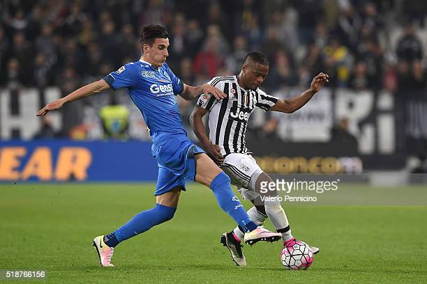 Patrice Evra of Juventus FC is challenged by Alessandro Pi of Empoli FC during the Serie A match between Juventus FC and Empoli FC at Juventus Arena...