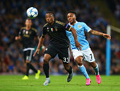 Patrice Evra of Juventus holds off Raheem Sterling of Manchester City during the UEFA Champions League Group D match between Manchester City FC and...