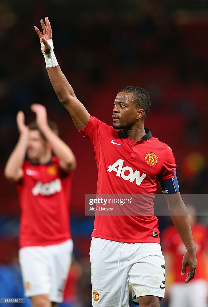<a gi-track='captionPersonalityLinkClicked' href=/galleries/search?phrase=Patrice+Evra&family=editorial&specificpeople=714865 ng-click='$event.stopPropagation()'>Patrice Evra</a> of Manchester United acknowledges the crowd at the end of the UEFA Champions League Group A match between Manchester United and Real Sociedad at Old Trafford on October 23, 2013 in Manchester, England.