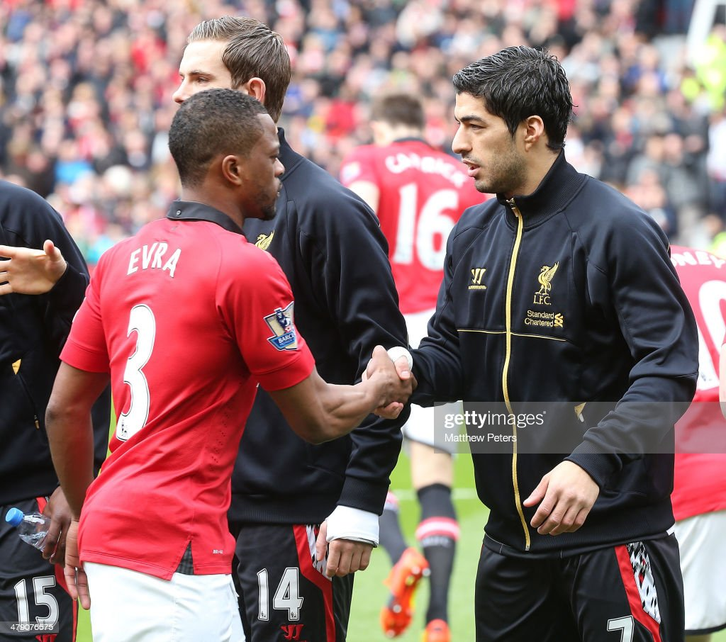 <a gi-track='captionPersonalityLinkClicked' href=/galleries/search?phrase=Patrice+Evra&family=editorial&specificpeople=714865 ng-click='$event.stopPropagation()'>Patrice Evra</a> of Manchester United and Luis Suarez of Liverpool shakes hands ahead of the Barclays Premier League match between Manchester United and Liverpool at Old Trafford on March 16, 2014 in Manchester, England.