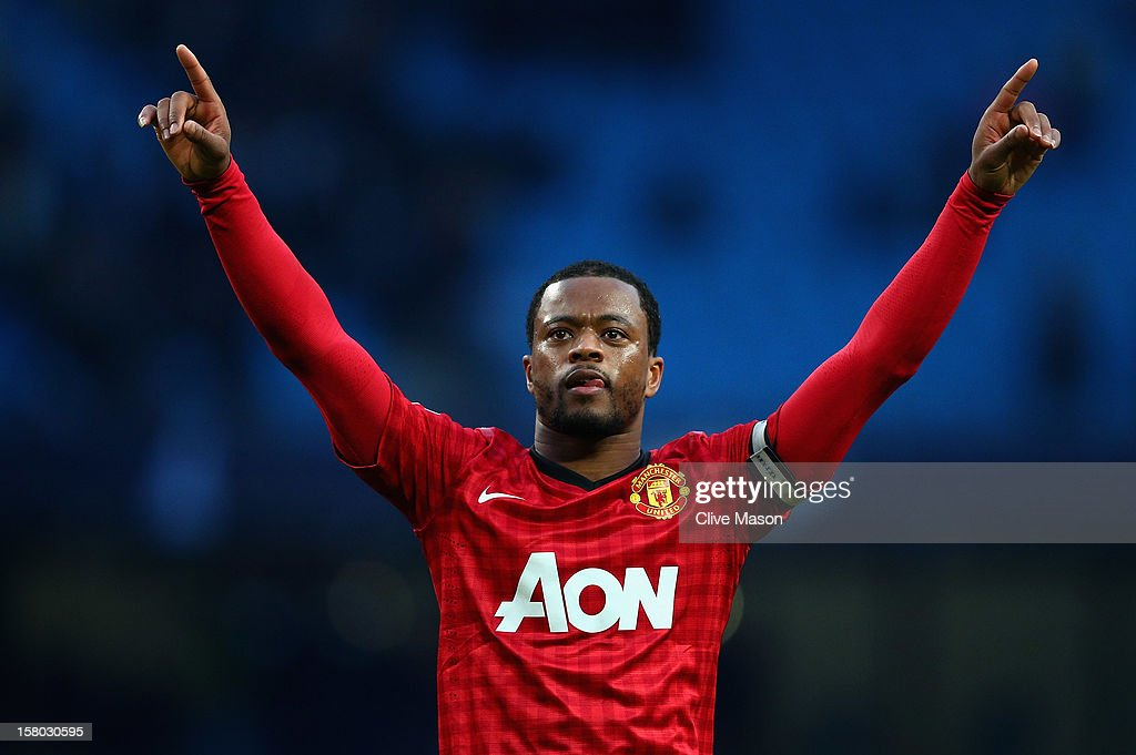 Patrice Evra of Manchester United celebrates at the end of the Barclays Premier League match between Manchester City and Manchester United at Etihad Stadium on December 9, 2012 in Manchester, England.