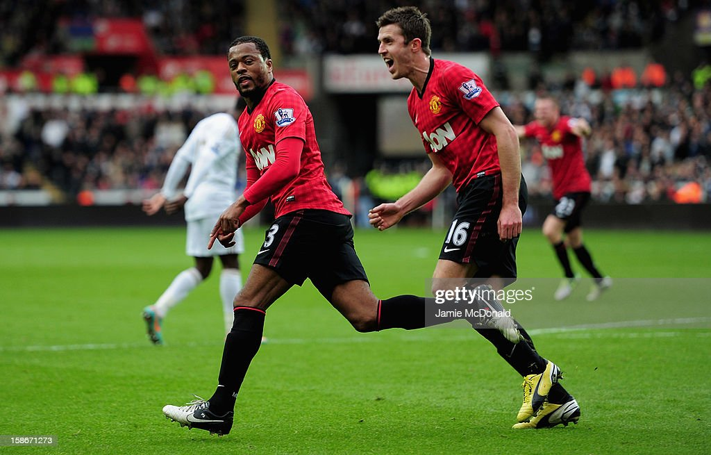 <a gi-track='captionPersonalityLinkClicked' href=/galleries/search?phrase=Patrice+Evra&family=editorial&specificpeople=714865 ng-click='$event.stopPropagation()'>Patrice Evra</a> of Manchester United celebrates his goal during the Barclays Premier League match between Swansea City and Manchester United at the Liberty Stadium on December 23, 2012 in Swansea, Wales.