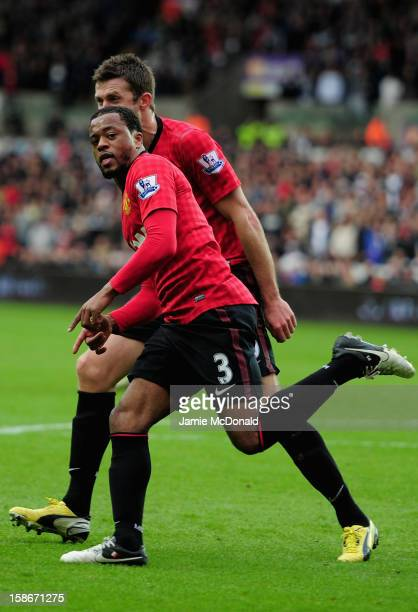 Patrice Evra of Manchester United celebrates his goal during the Barclays Premier League match between Swansea City and Manchester United at the...