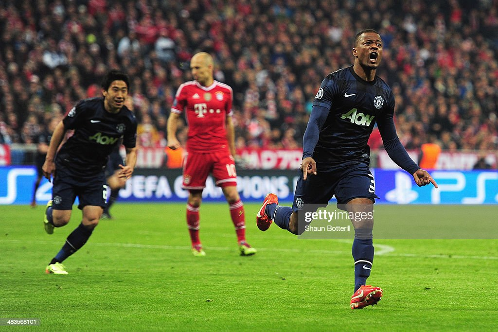 <a gi-track='captionPersonalityLinkClicked' href=/galleries/search?phrase=Patrice+Evra&family=editorial&specificpeople=714865 ng-click='$event.stopPropagation()'>Patrice Evra</a> (R) of Manchester United celebrates his goal during the UEFA Champions League Quarter Final second leg match between FC Bayern Muenchen and Manchester United at Allianz Arena on April 9, 2014 in Munich, Germany.