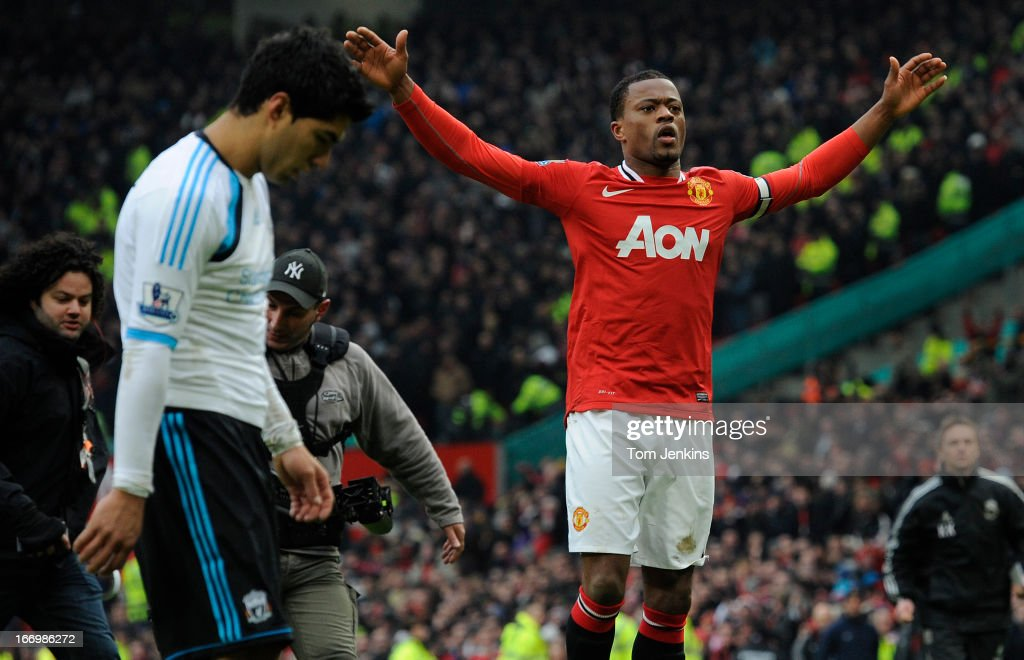 <a gi-track='captionPersonalityLinkClicked' href=/galleries/search?phrase=Patrice+Evra&family=editorial&specificpeople=714865 ng-click='$event.stopPropagation()'>Patrice Evra</a> of Manchester United (right) celebrates in front of Luis Suarez of Liverpool (left) after the Manchester United versus Liverpool FA Premier League match at Old Trafford on February 11, 2012 in Manchester.