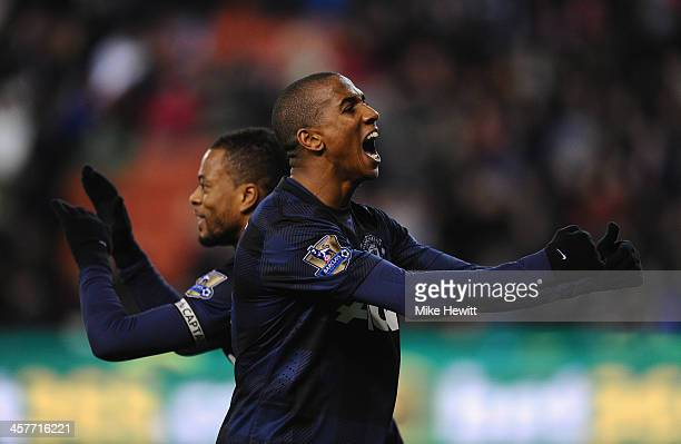 Patrice Evra of Manchester United celebrates scoring his team's second goal with teammate Ashley Young during the Capital One Cup Quarter Final match...